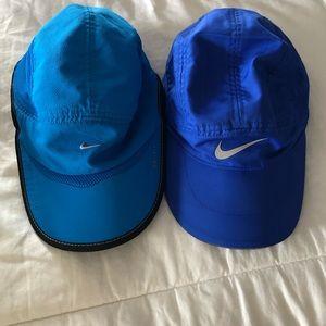 2 blue nike hats !